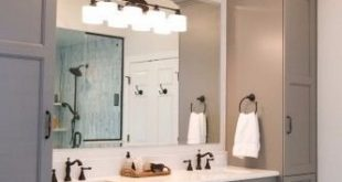 Grey master vanity with two towers, undermount sinks, antique bronze faucets and...