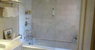 What a wonderful bathroom. Love the molding around the tub.