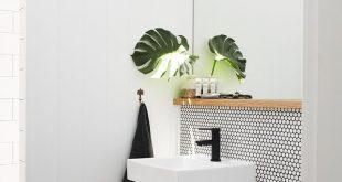 Kleines Gäste-WC mit weißem Knopfmosaik, rundem Mosaik, modernes Gäste-WC