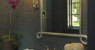 Dark grasscloth and stone vanity, stainless sink, beautiful mirror, interesting ...